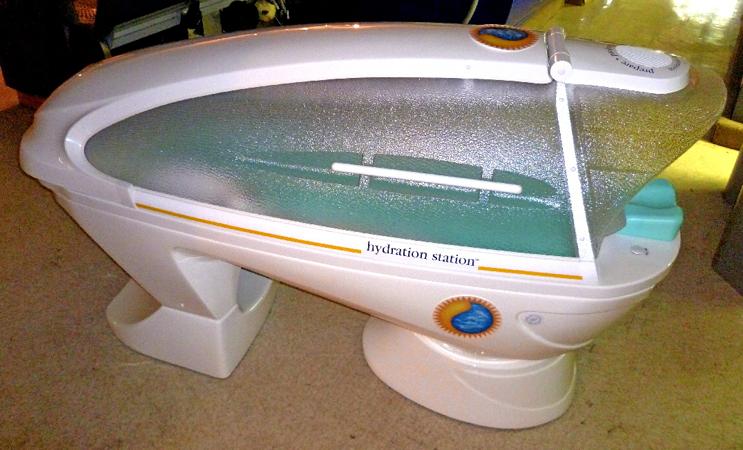 this is a photo of a used hydration station spa capsule used for body wraps